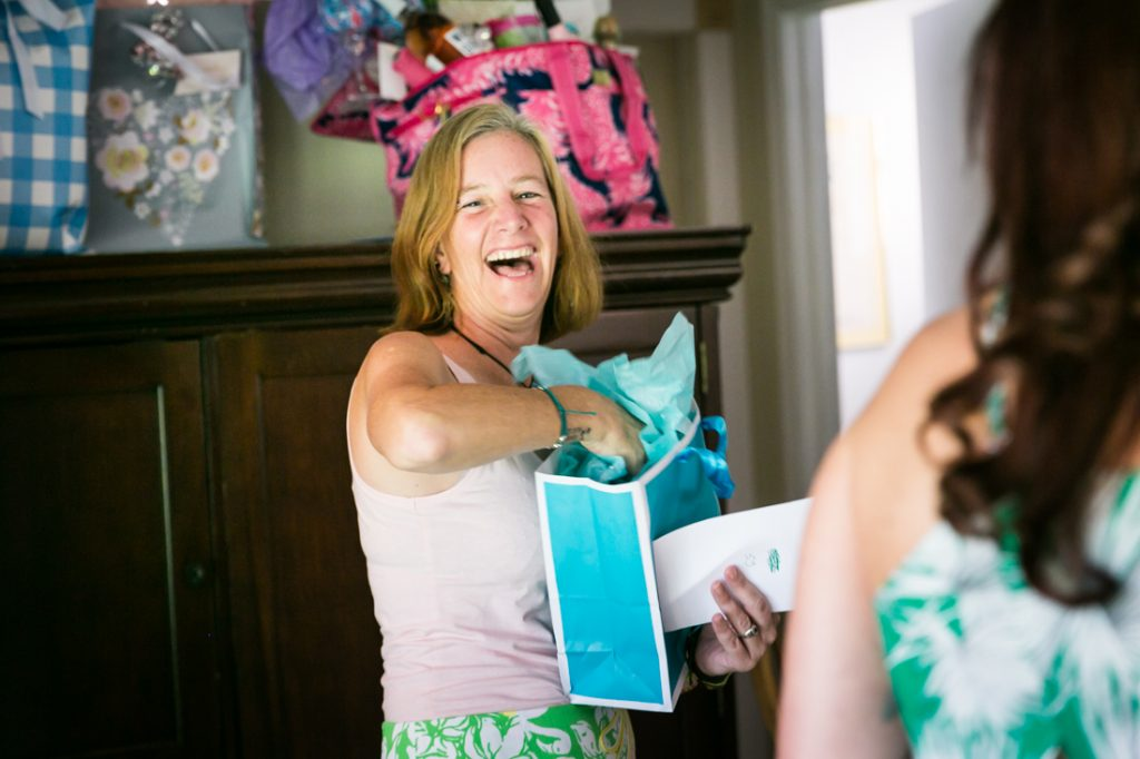 Guest opening gift in blue bag during Florida bridal shower