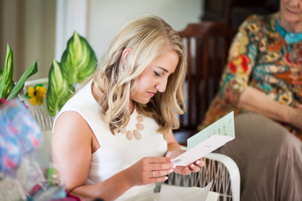 Bride-to-be reading card during Florida bridal shower