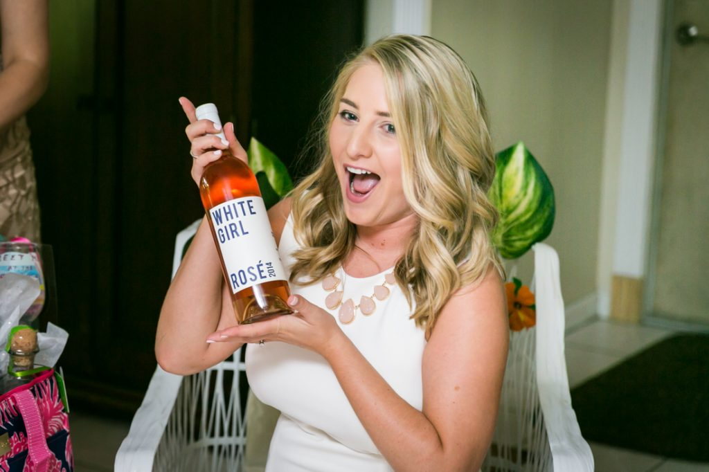 Bride-to-be showing bottle of wine during Florida bridal shower