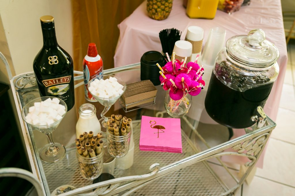 Coffee bar with marshmallows, liquor, and pink napkins