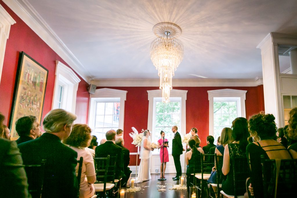India House wedding photos of wedding ceremony and chandelier