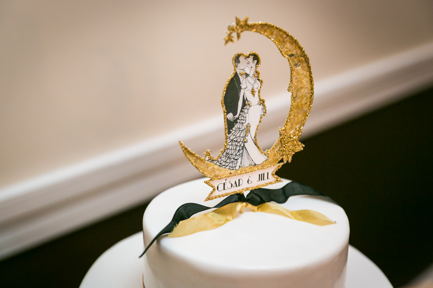 1920s theme wedding cake topper with moon and bride and groom