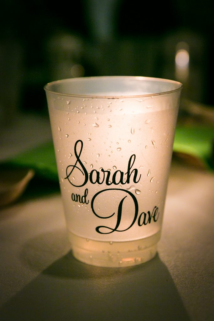 Glowing cup with the words 'Sarah and Dave' on it