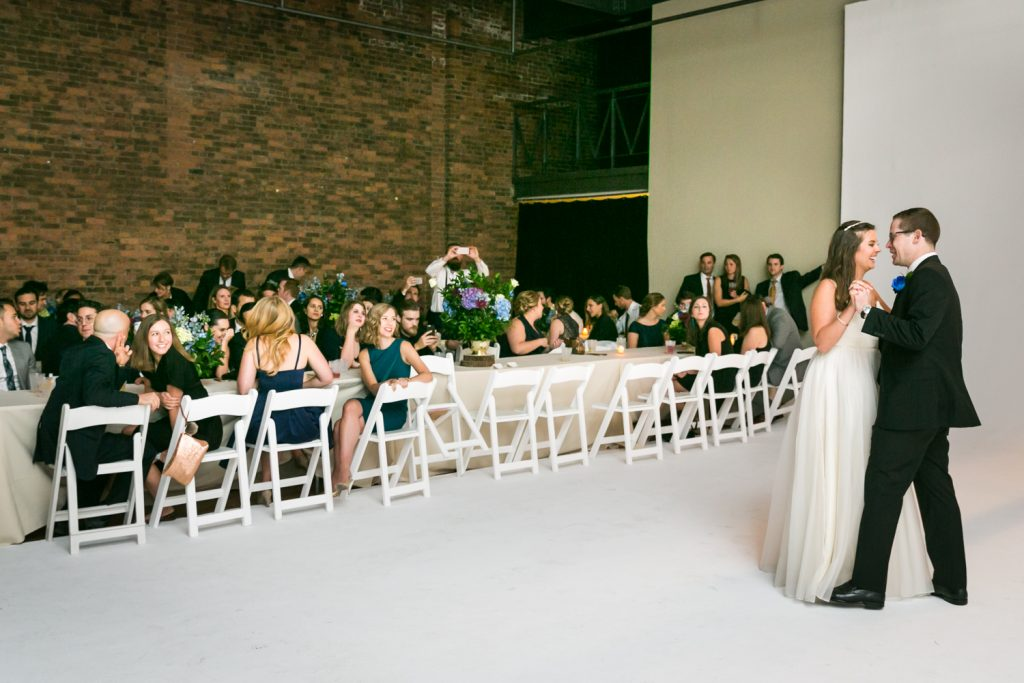 Bride and groom dancing in front of guests at Bathhouse Studios wedding reception