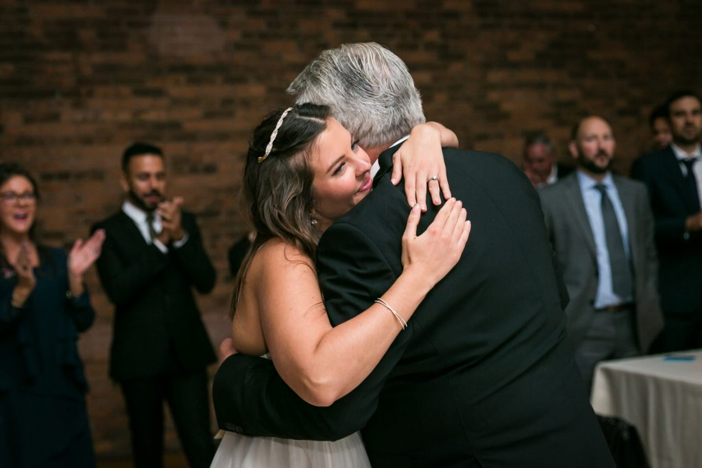 Bride hugging father at Bathhouse Studios wedding reception