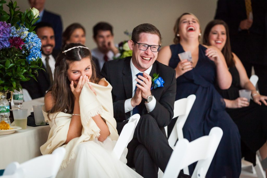Bride and groom laughing during Bathhouse Studios wedding reception
