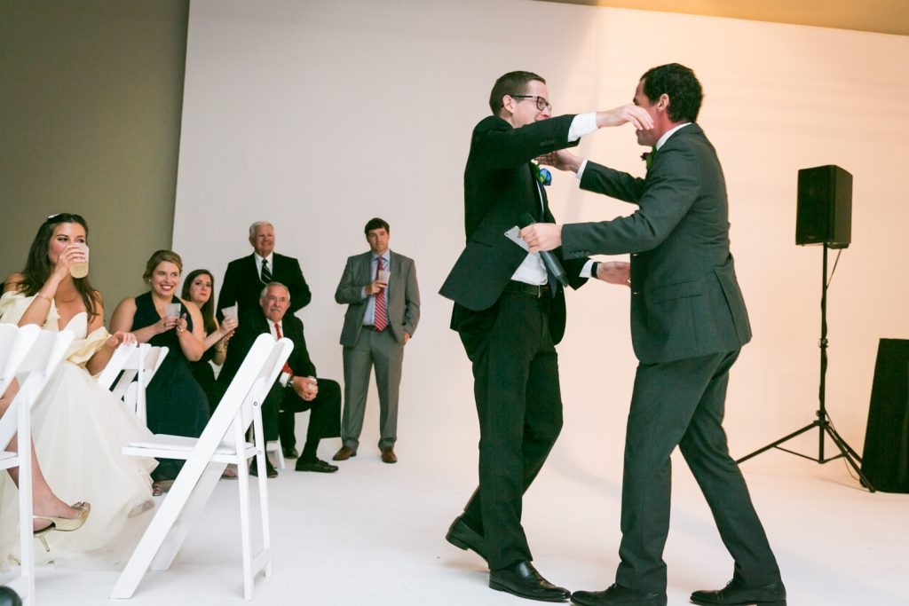 Groom hugging guest after speech