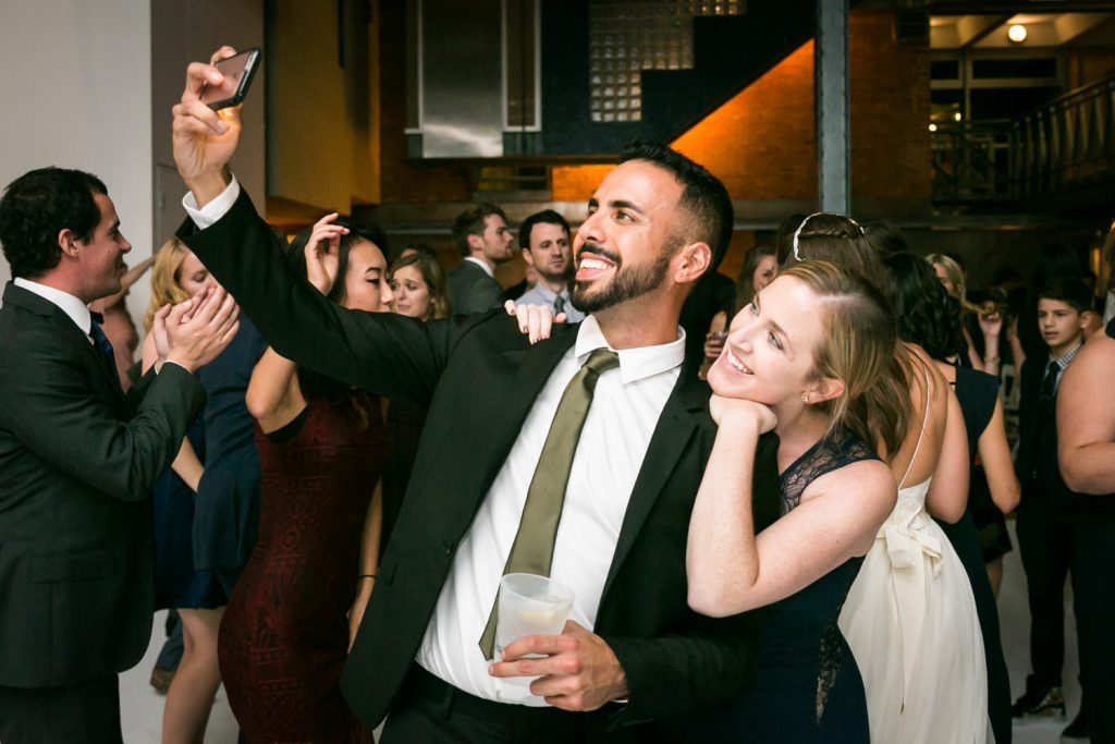 Man and woman taking selfie on dance floor at Bathhouse Studios wedding