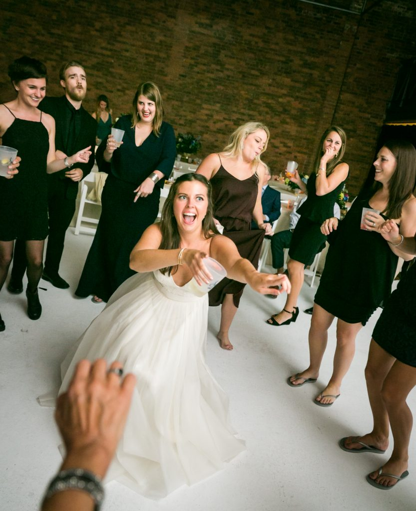 Bride pointing at guests on the dance floor