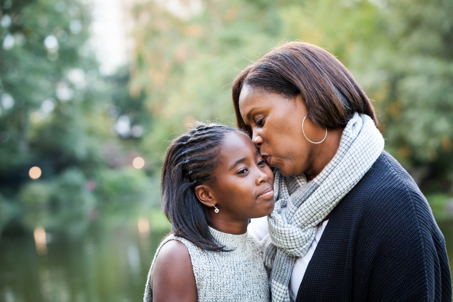 Central Park fall family portrait of mother kissing daughter's face