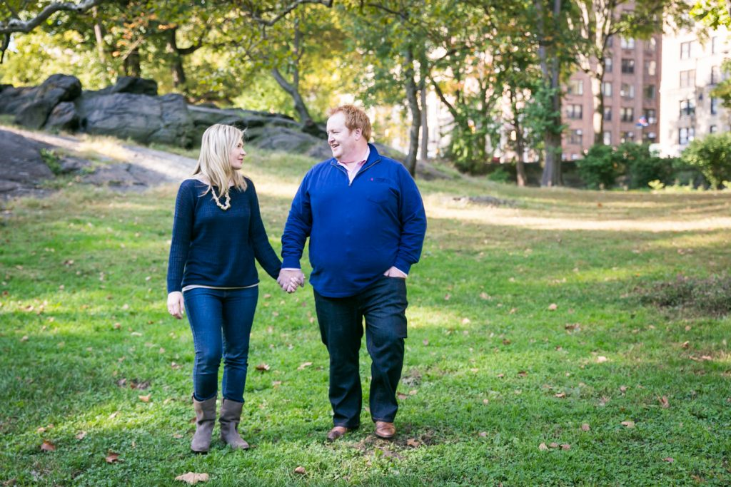 Central Park family photos couple walking across grass