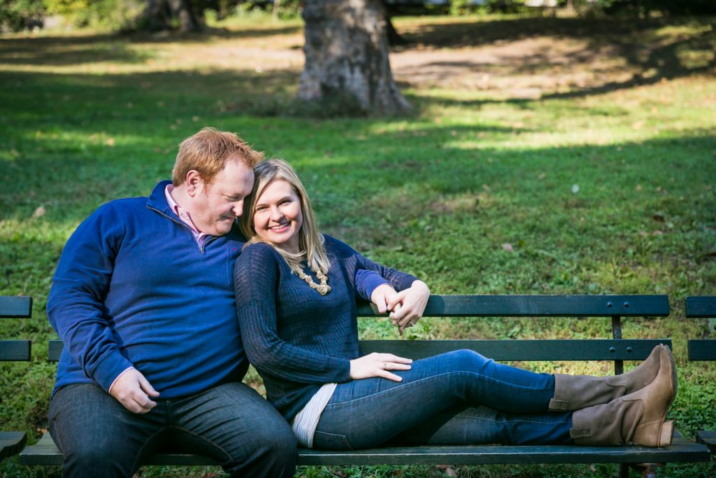 Central Park family photos of couple sitting on bench