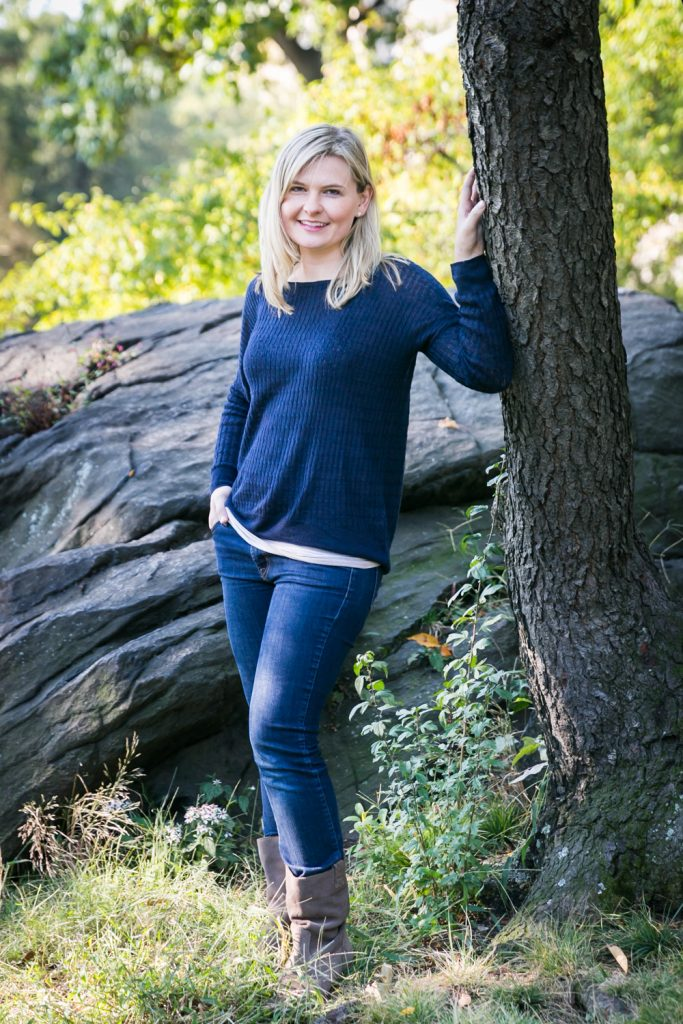 Central Park family photos of woman standing by tree