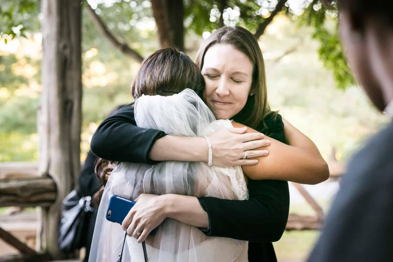 Guest hugging bride in Cop Cot wedding