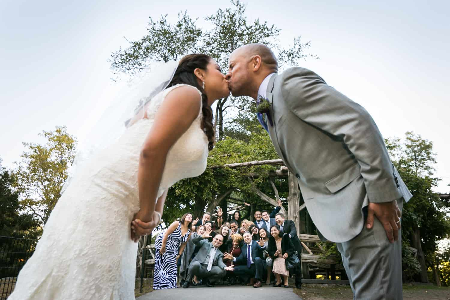 View through bride and groom kissing of guests in Cop Cot wedding