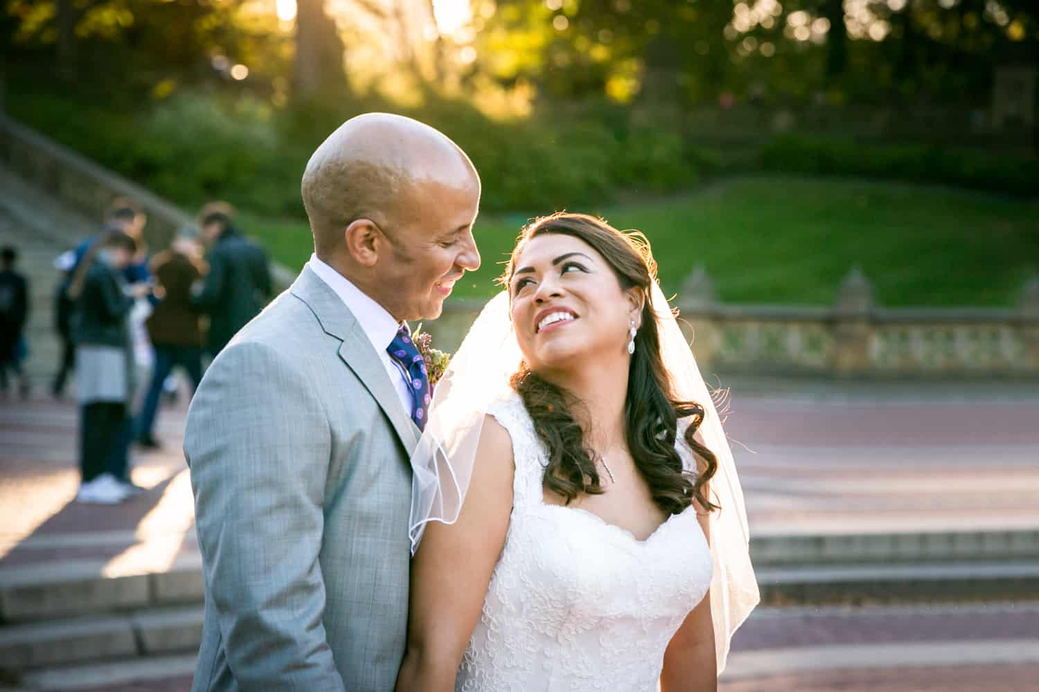 Bride and groom smiling at Bethesda Fountain in Central Park