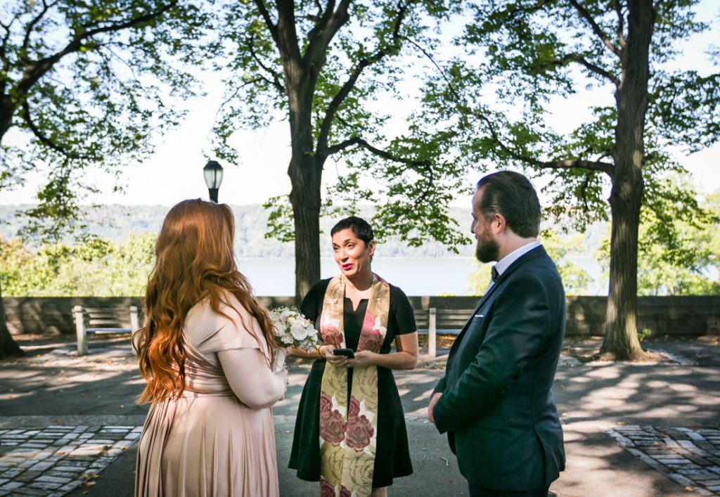 Officiant speaking to bride and groom during ceremony for an article on how to plan a destination wedding