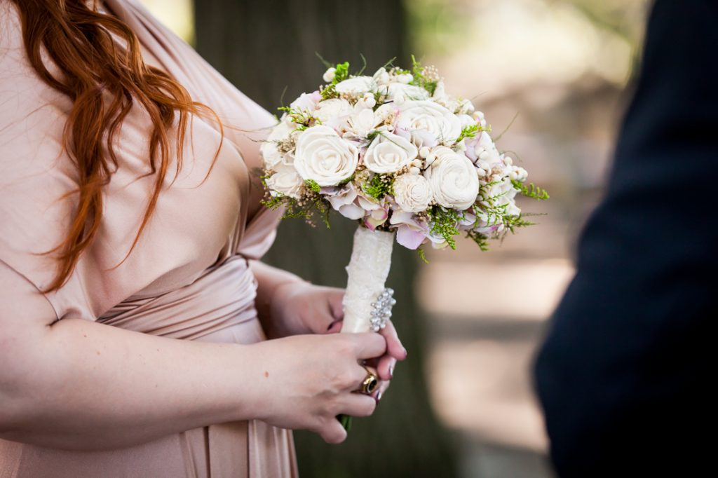 Close up of bride holding flower bouquet