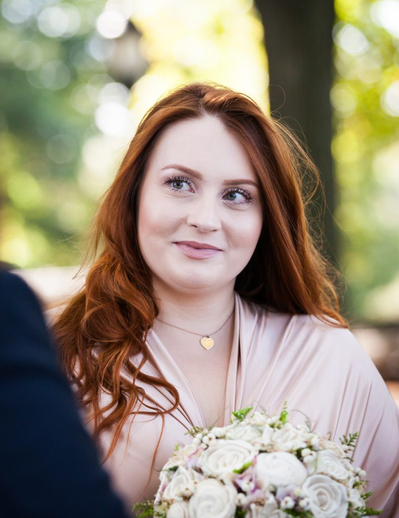 Bride looking at groom during ceremony for an article on how to plan a destination wedding