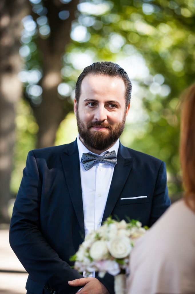 Groom looking at bride during ceremony for an article on how to plan a destination wedding