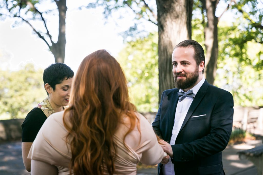 Bride and groom exchanging vows for an article on how to plan a destination wedding
