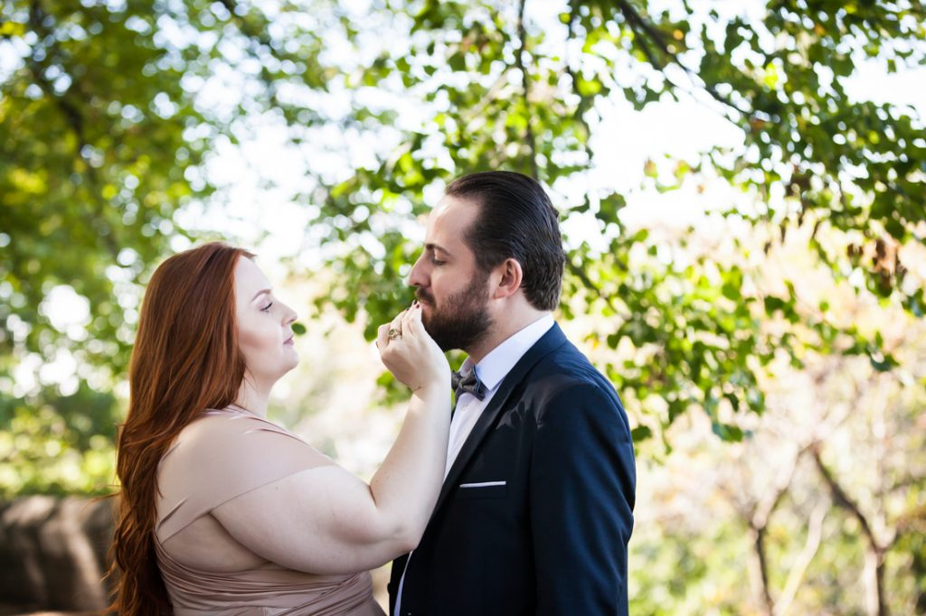 Bride touching groom's moustache