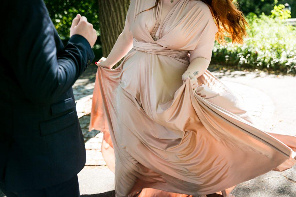 Close up of bride dancing in rose pink wedding dress