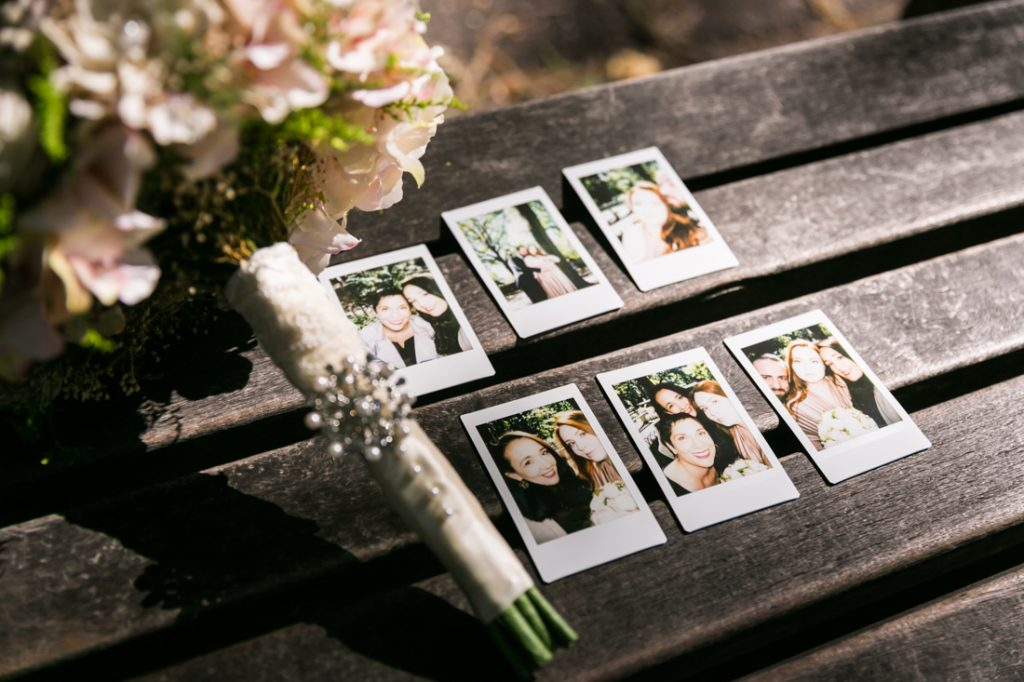 Snapshots of wedding party on picnic table with flower bouquet