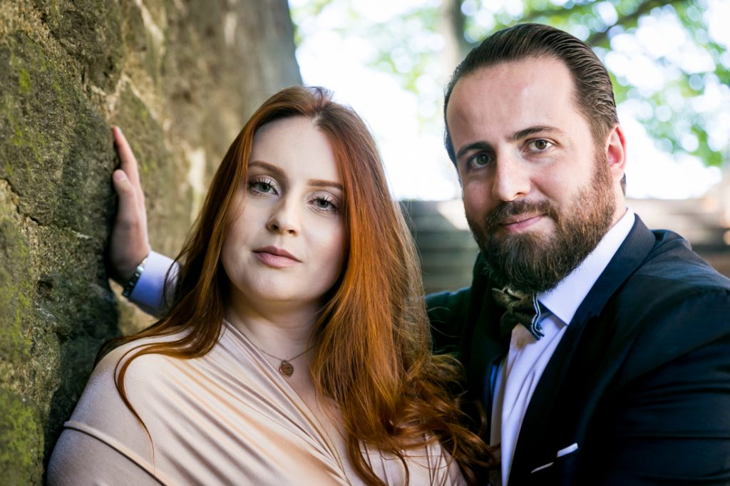 Bride and groom in stone stairwell in Fort Tryon Park
