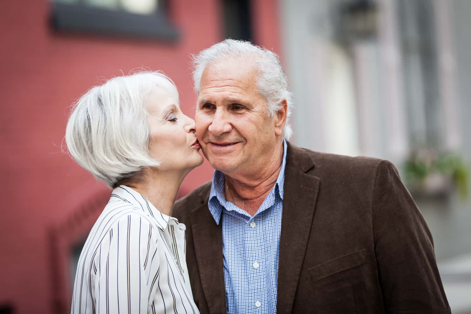 Older woman kissing man on the cheek