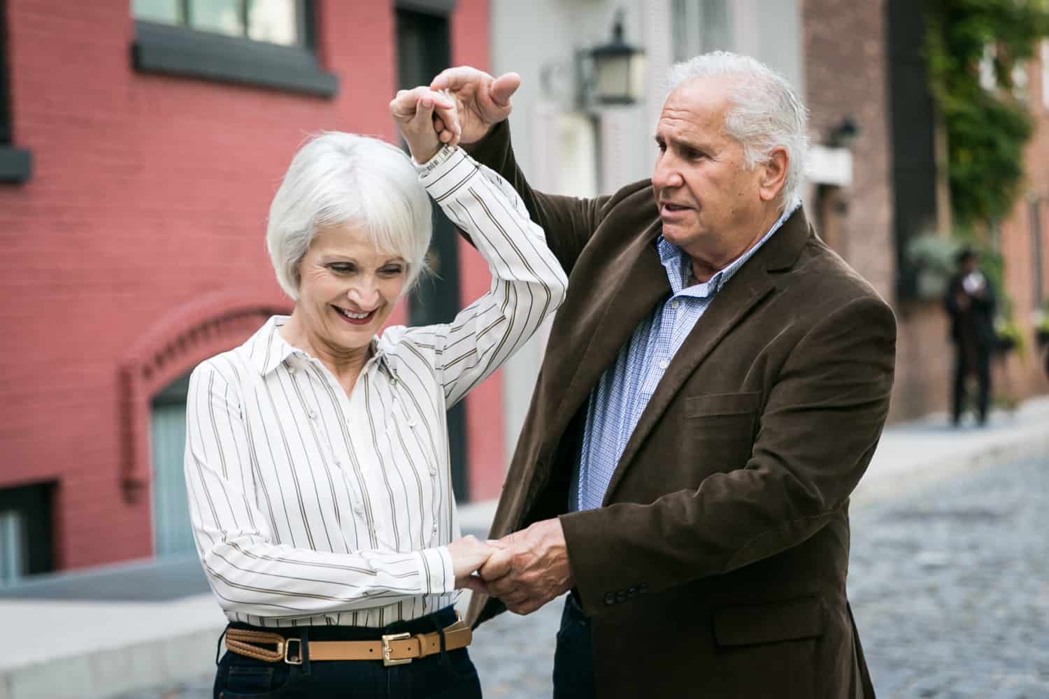 Photojournalistic portraits of older couple dancing in Washington Mews