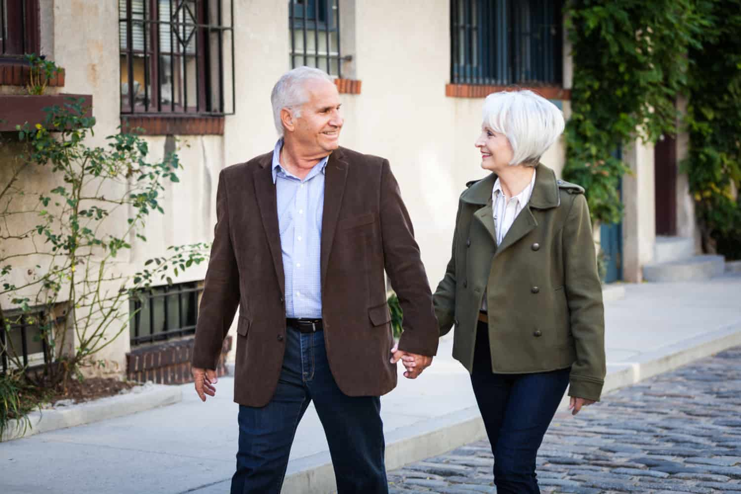 Photojournalistic portraits of older couple walking in Washington Mews