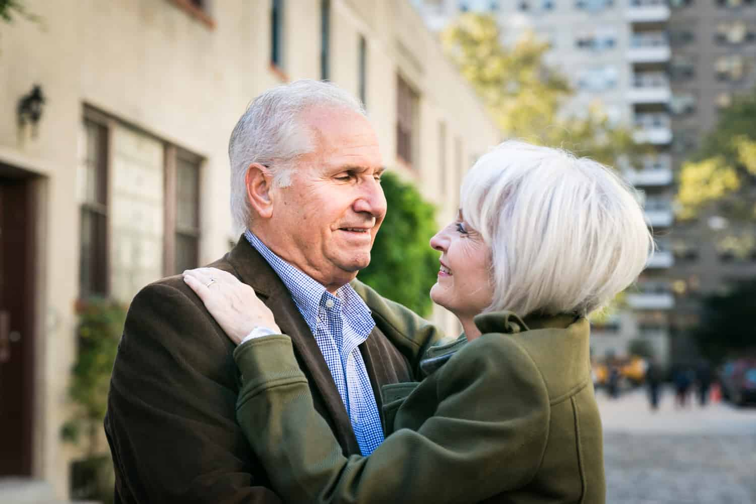 Photojournalistic portraits of older couple hugging in Washington Mews