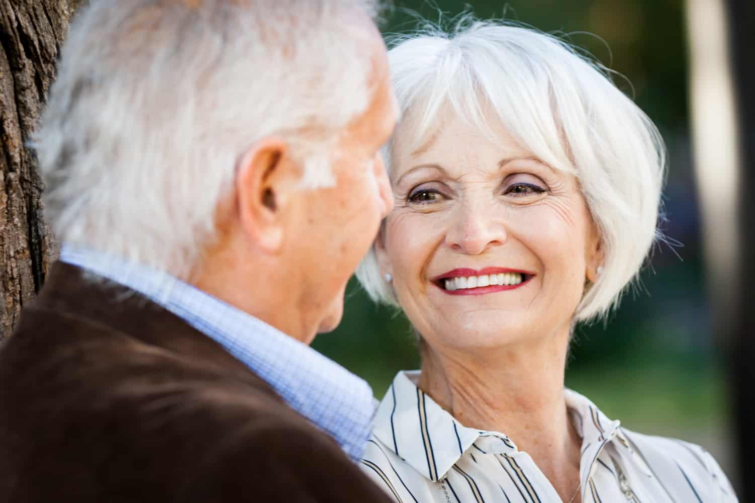 Older woman looking at man and laughing