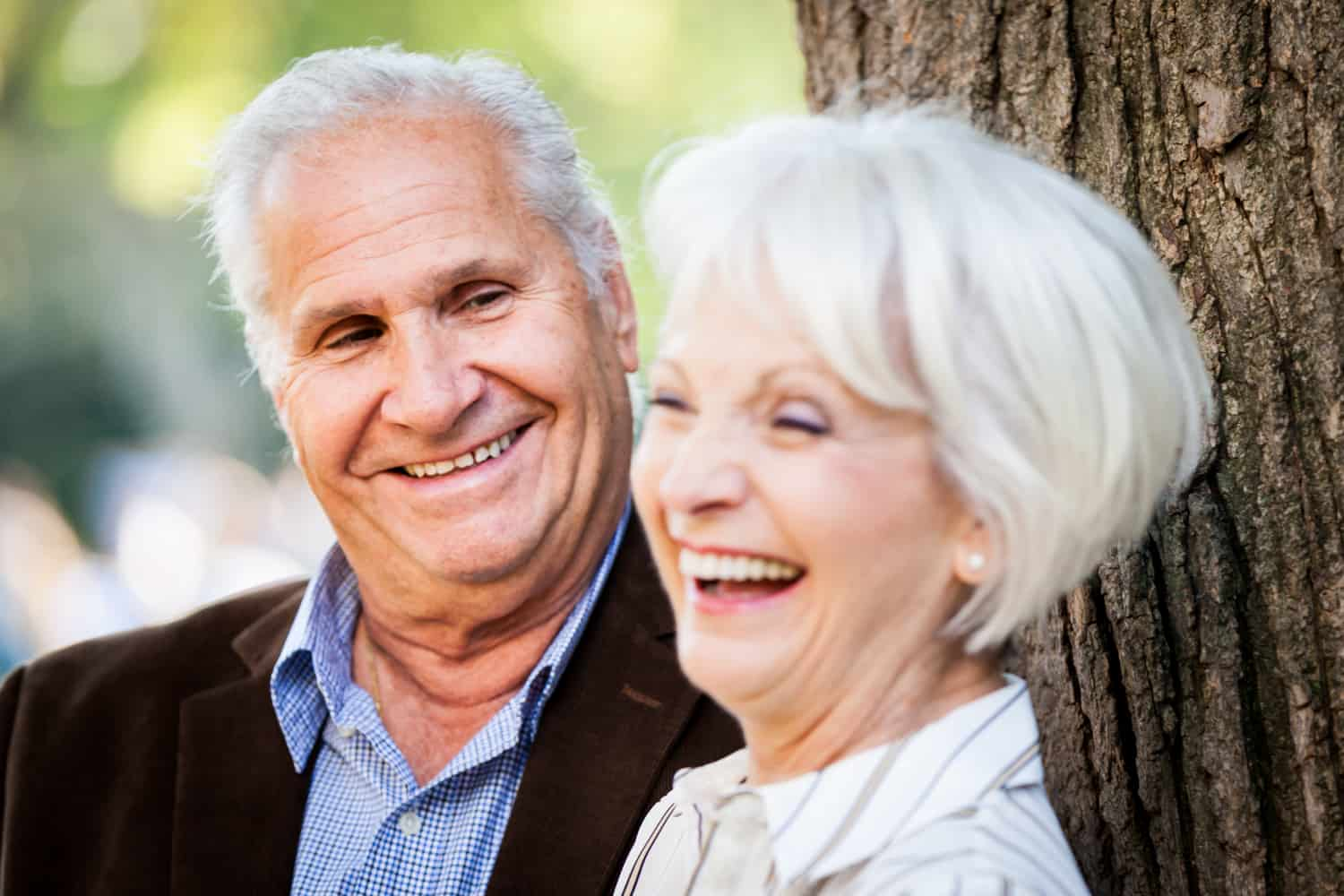 Older man looking at laughing older woman