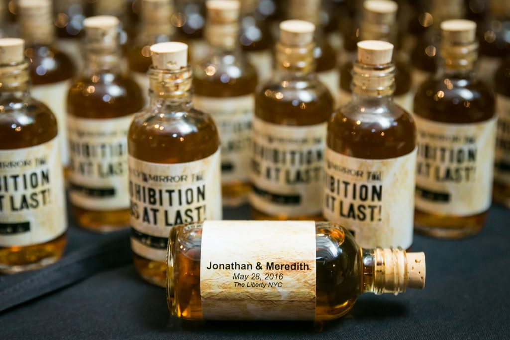 Mini bottle of whiskey personalized with name of bride and groom