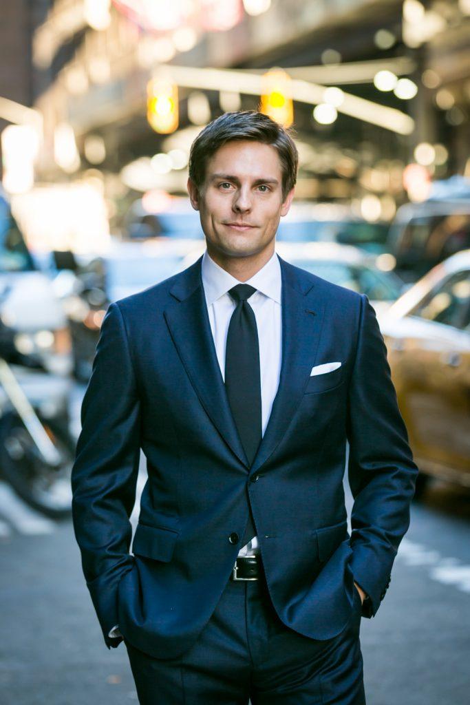 Portrait of groom standing on NYC street