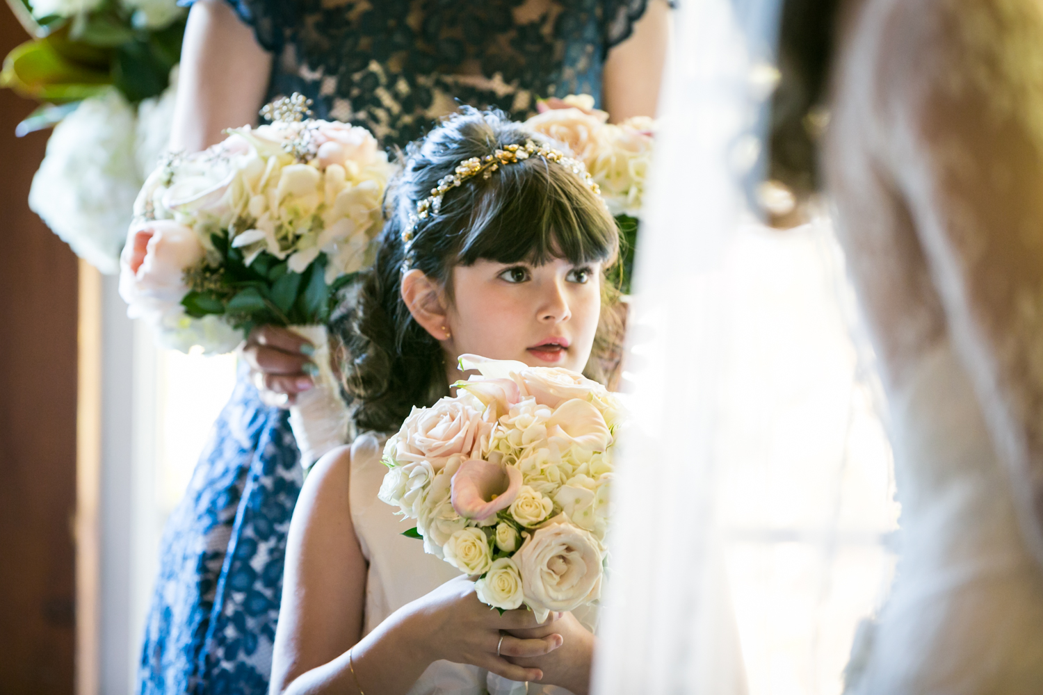 Flower girl watching ceremony at a Loeb Boathouse wedding in Central Park
