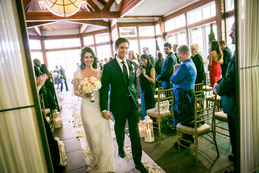 Bride and groom walking down aisle after ceremony