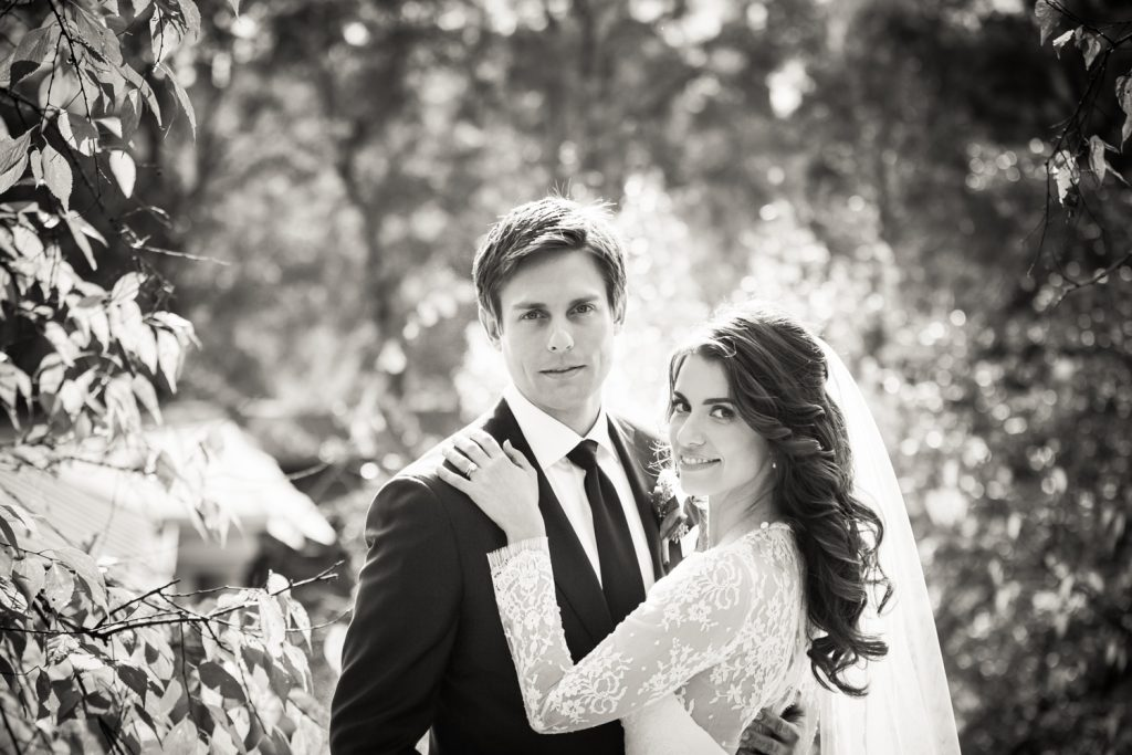 Black and white photo of bride and groom in Central Park