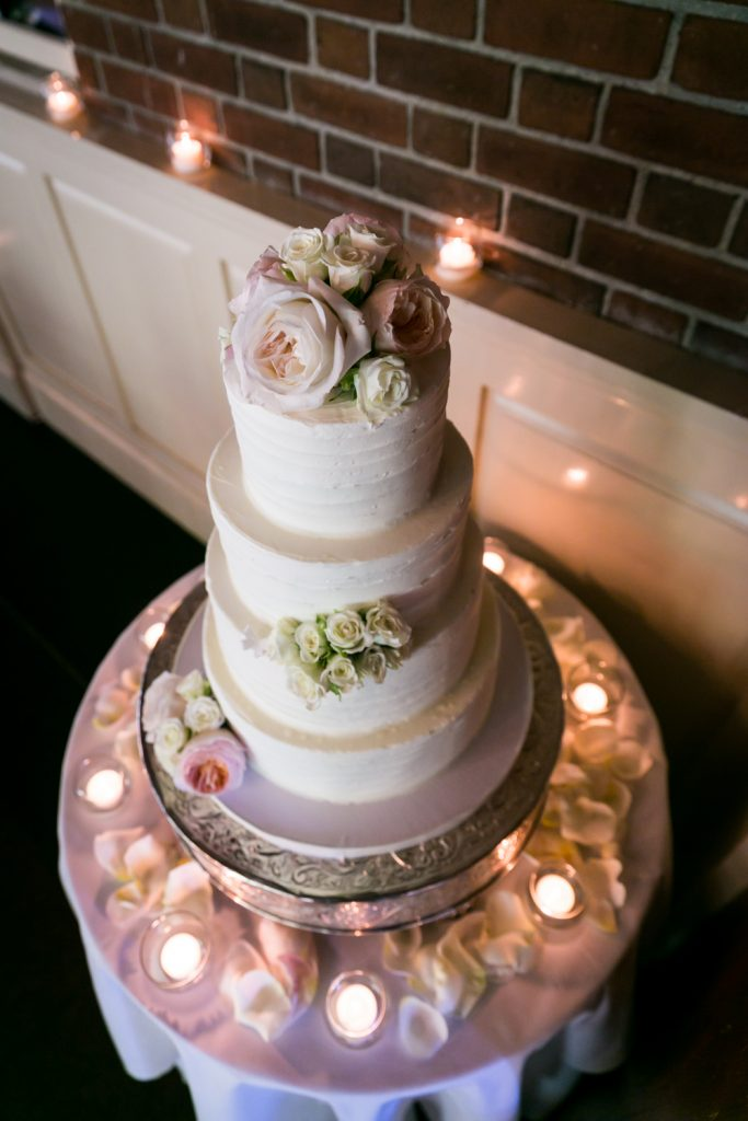 Four layer wedding cake with flowers