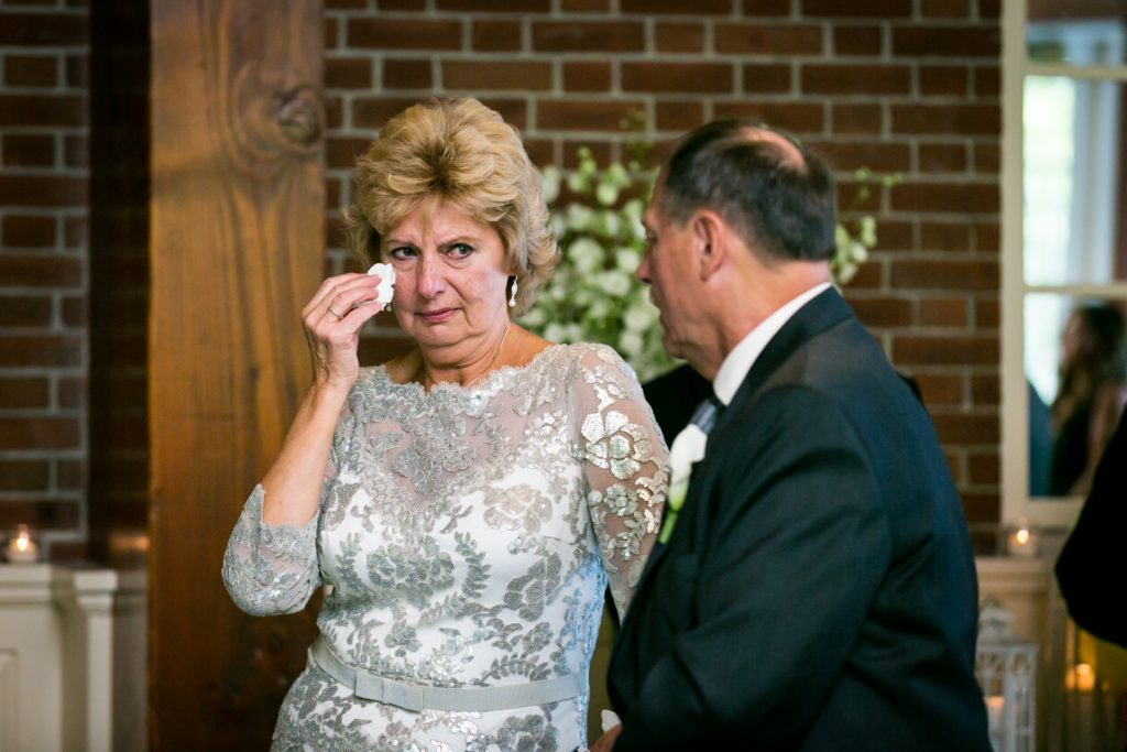Mother of groom wiping away a tear