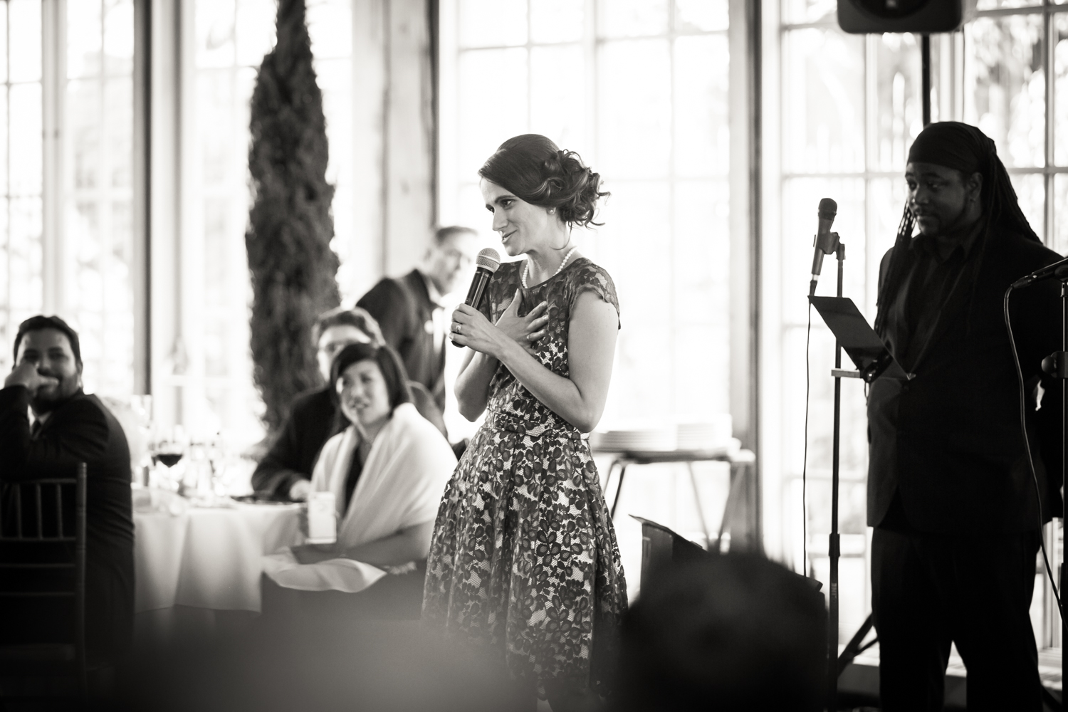 Black and white photo of maid of honor making toast