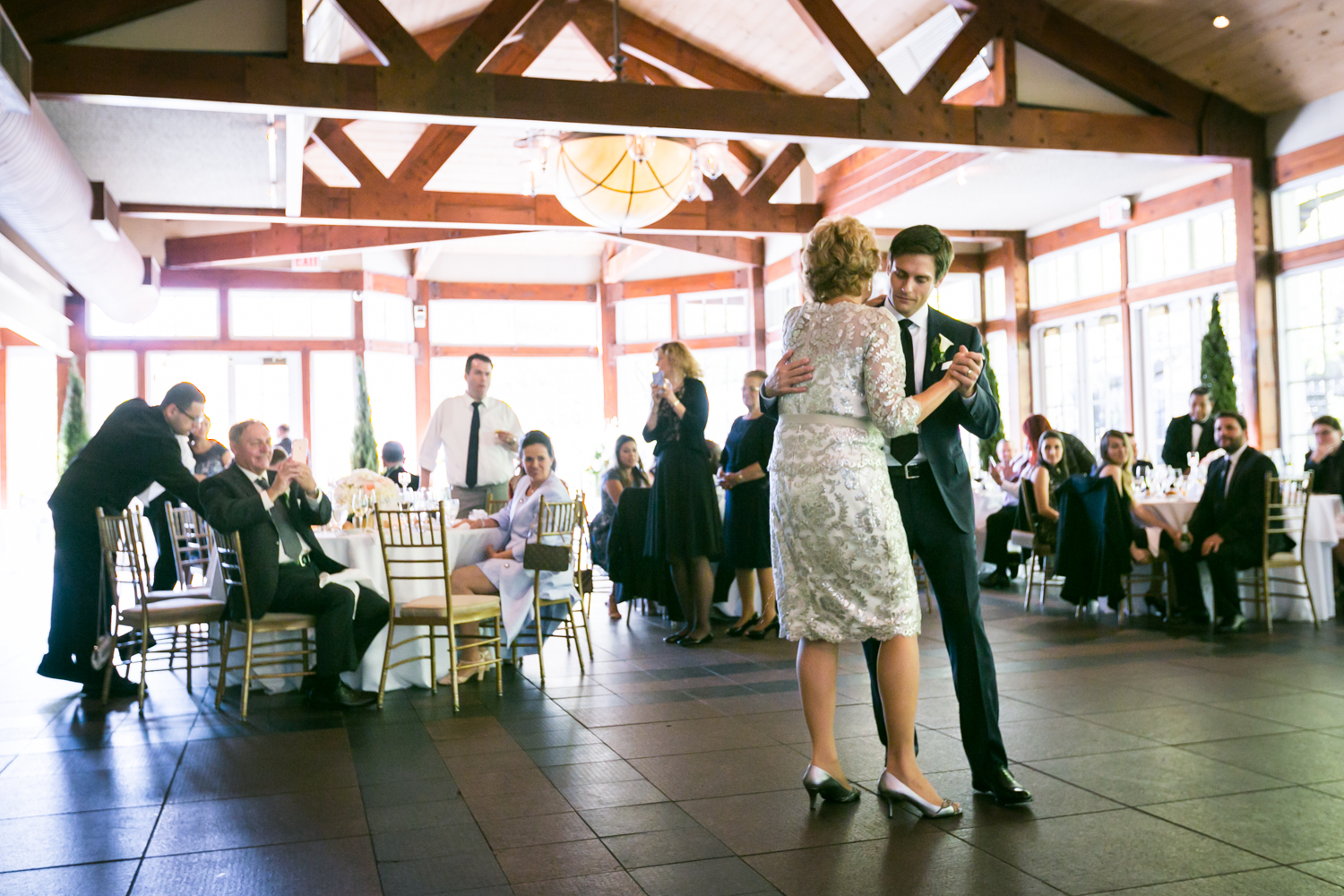Groom dancing with mother at a Loeb Boathouse wedding in Central Park