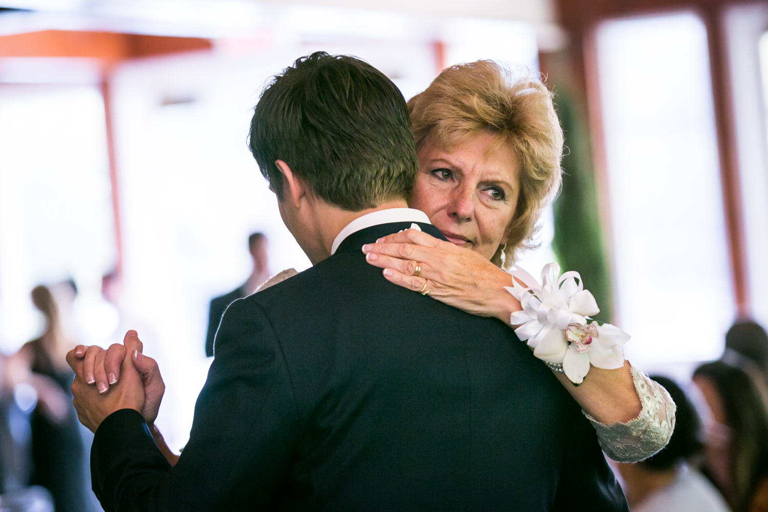 Mother and groom dancing at a Loeb Boathouse wedding in Central Park