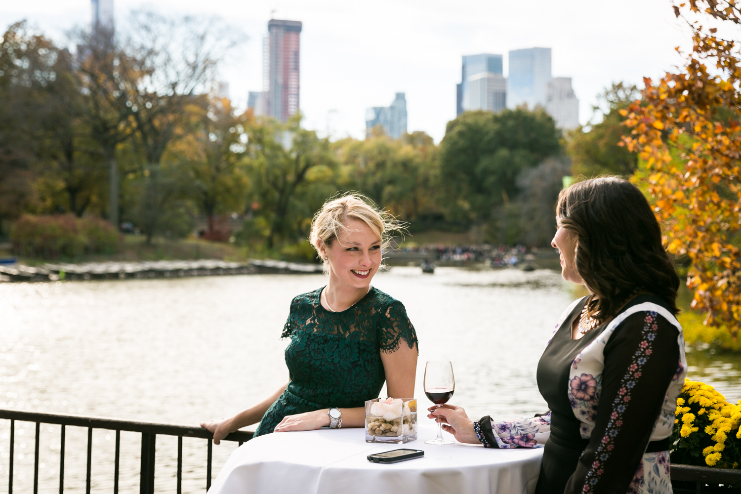Two guests at a table on the patio at the Loeb Boathouse