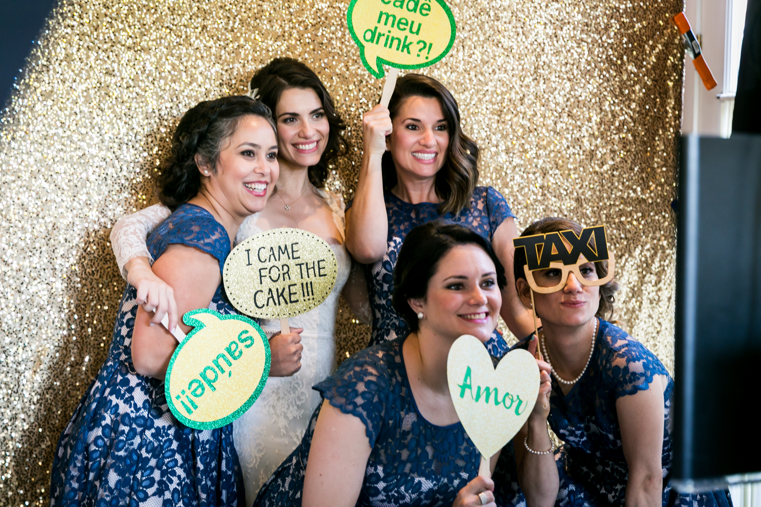 Bride and four female guests in a photobooth