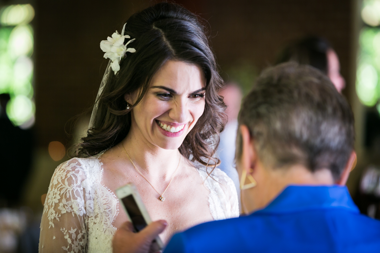 Bride smiling at guest at a Loeb Boathouse wedding in Central Park
