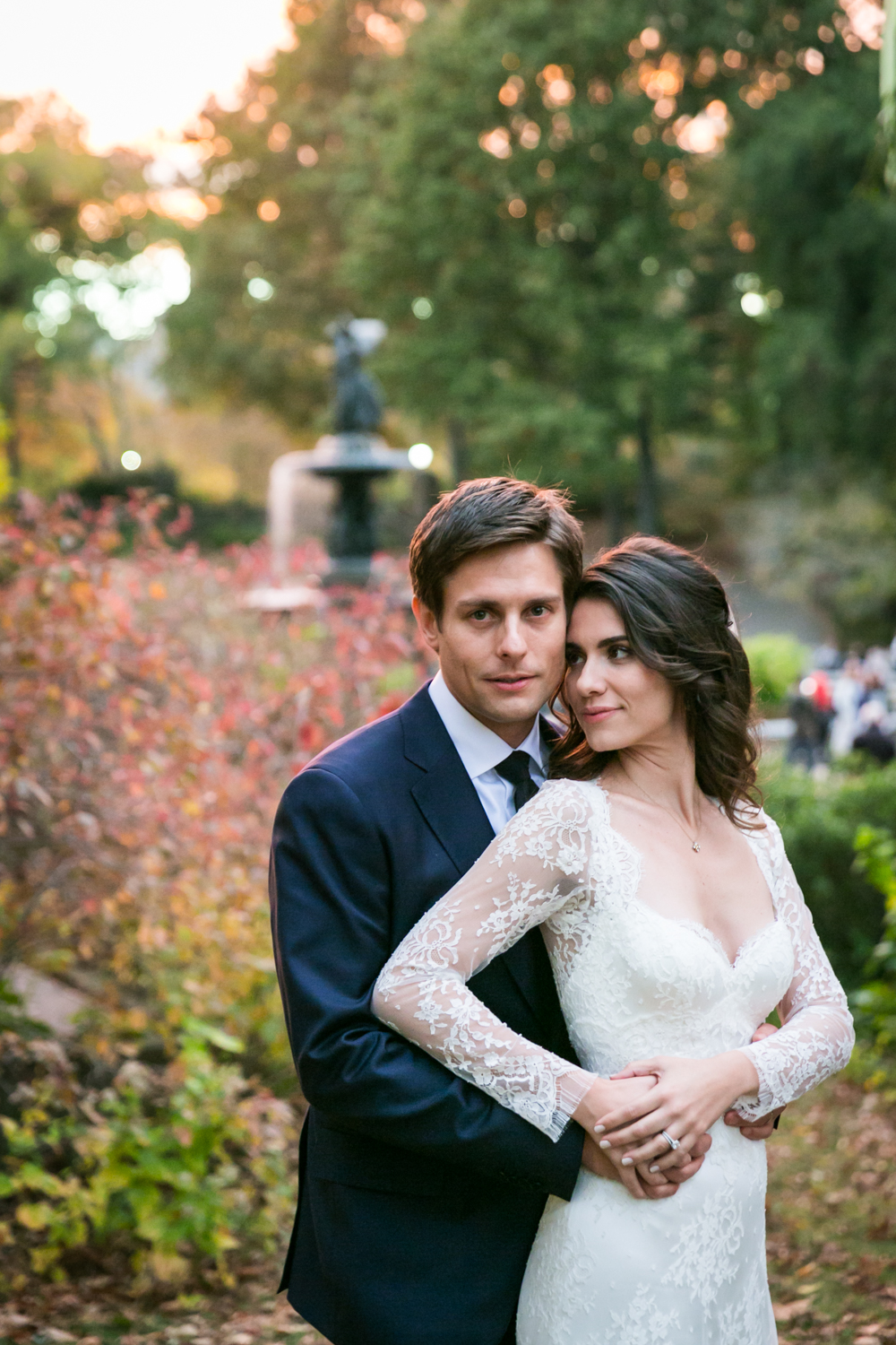 Bride and groom in Central Park with Bethesda Fountain in background