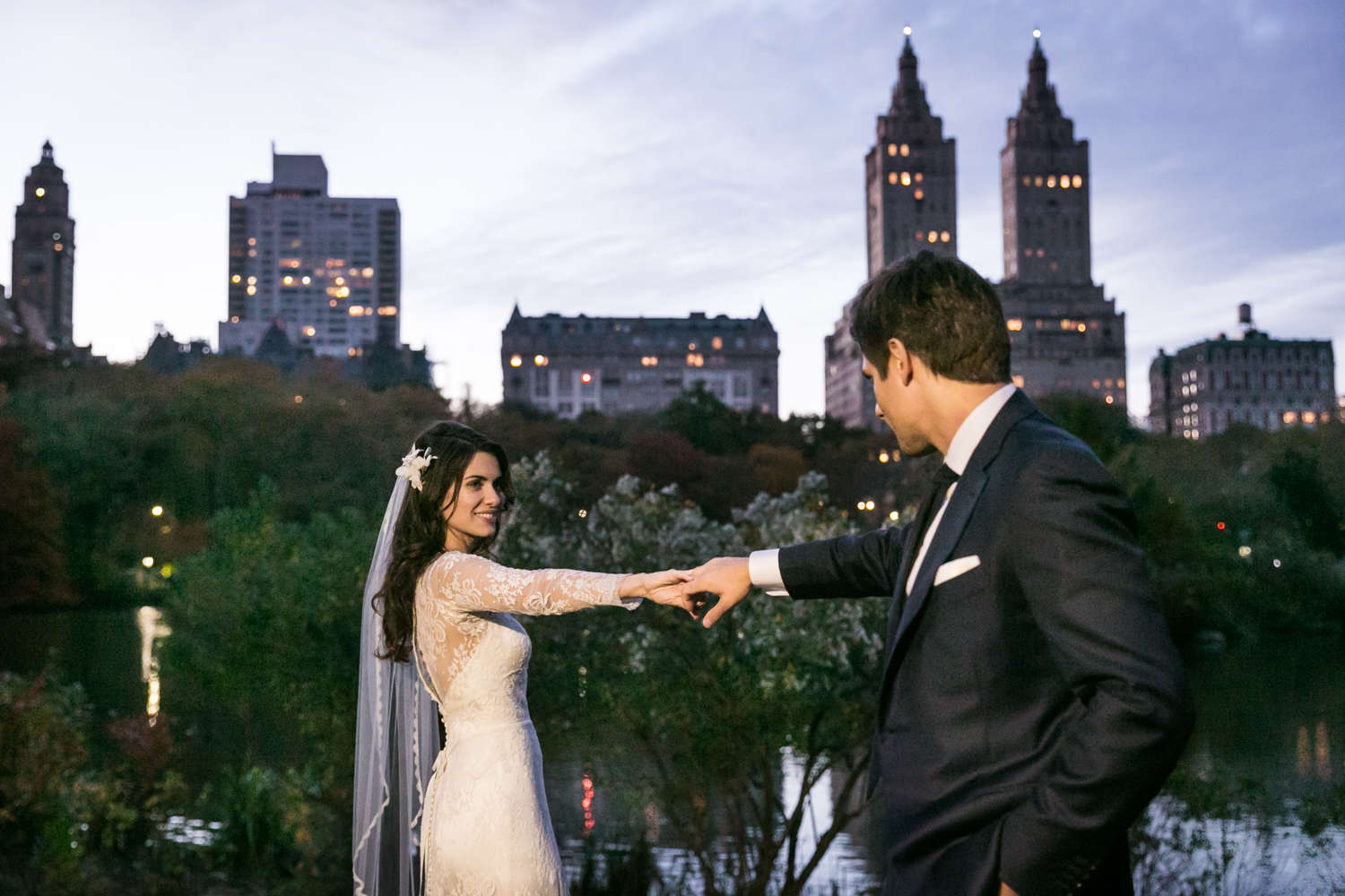 Bride and groom dancing in Central Park at night at a Loeb Boathouse wedding